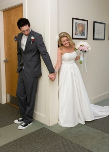Marissa and Pete praying before their wedding ceremony last Sunday.