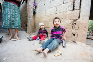 Yalu, Guatemala. Children sitting at home.